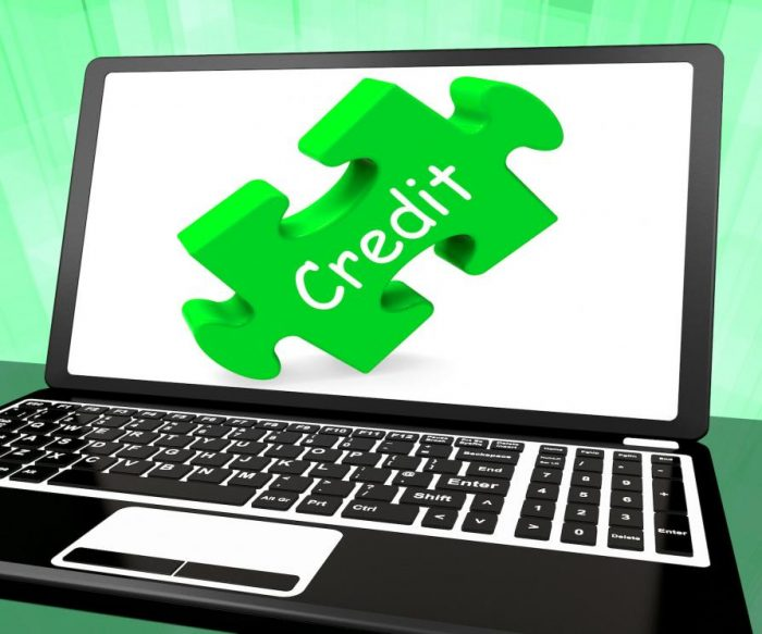 Laptop with credit puzzle